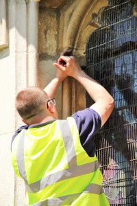 Aiano engineer, Adrian, removes one of old window guards