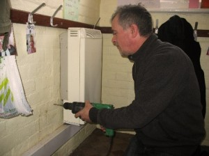 AIANO senior engineer Steve installing one of the bespoke radiator guards.