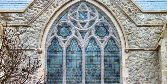Aiano woven-mesh window guards , visible on the main window at Highgate Road Chapel