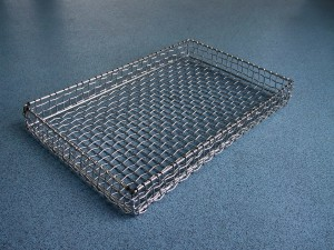 AIANO bespoke wire mesh guard used as a hospital tray