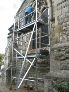 Aiano senior engineer, Steve, fixing the new traditional window guards at St. Paul's Church