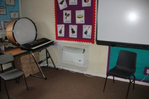 One of the AIANO Classic bespoke heater guards in the school music room