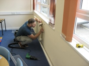 AIANO engineering installing bespoke radiator guards