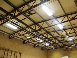 AIANO bespoke light guards in school sports hall