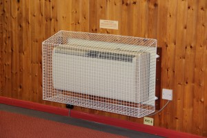 One of the AIANO sloping top heater guards for the Xpelair air-conditioning unit in 4th East Barnet Scout group hall.