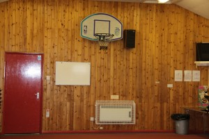 One of the Aiano Classic sloping top heater guards installed under a Basketball net