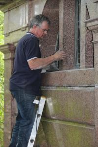 AIANO senior engineer Steve installing the stainless steel window guards at the Pocklington mausoleum