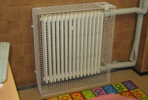One of the bespoke heater guards for which the central heating pipes presented a design challenge as cut outs were necessary to ensure the guard fit over the radiator