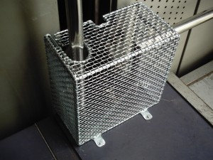 AIANO bespoke wire mesh guard for a lift mechanism.