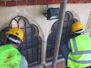 AIANO engineers installing church window guards