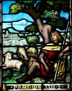 Detail showing part of a stained glass guarded by AIANO hand-woven church window guards depicting the shepherd and sheep of Psalm 23